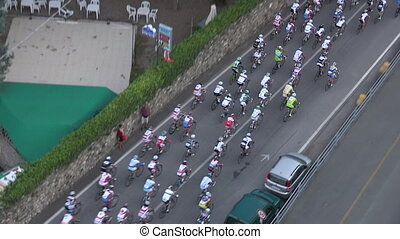 Cyclists at the head of a race - Pack of cyclists taking the...