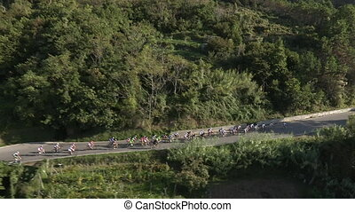 Large pack of cyclists together on a flat stretch of road