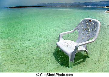 Easy Chair at the Dead Sea - A lone salt covered plastic...
