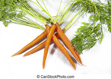 Criss Cross Carrots - Carrots stacked in a crisscrossed...