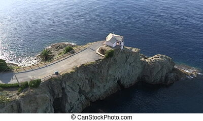 Small church on rocky peninsula - Aerial view of small...
