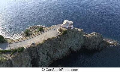 Small church on rocky peninsula