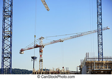 Construction Site Cranes - Low angle view of a tower crane...