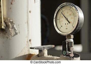 Industrial Pressure Gauge - Industrial pressure gauge on a...