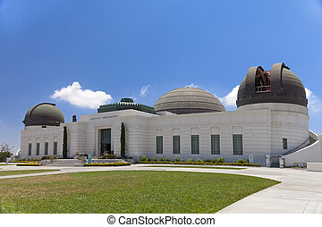 Griffith observatory with green grass field and sunny day