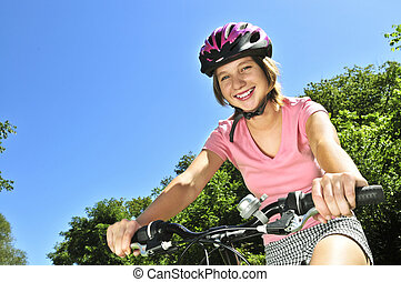 Teenage girl on a bicycle - Portrait of a teenage girl on a...