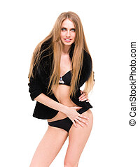 woman in lingerie and fur coat posing