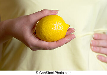 girl in a yellow dress holding lemon - girl in a yellow...