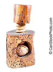 Old beech wood nutcracker with walnut isolated on a white...