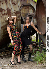 two fashion girls - two fashionable girls on the dirty...