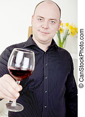 Man raising his glass in a toast - Attractive mature man...