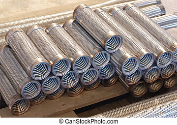 Heap of flexible metal hose - Heap of flexible metal hose in...