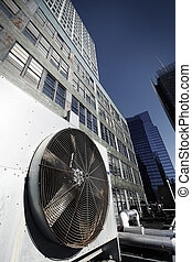 Wide angle view at an outdoor HVAC air conditioner unit...