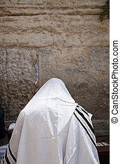 Praying in a Shawl - A Jewish man wearing a Jewish praying...