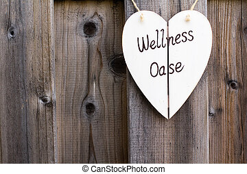 Wooden fence and wellness signboard - Old wooden fence with...