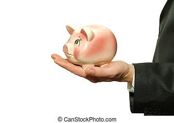 piggy bank in hand - saving money woman hands holding piggy...