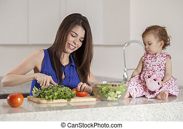 Mom and daughter making dinner