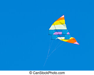 Various Colorful Kites Flying in a Bright Blue Sky at the...