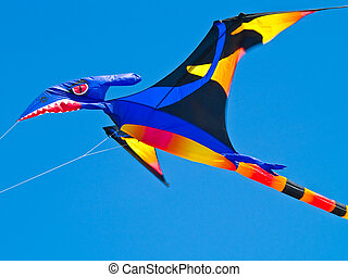 Colorful Pterodactyl Kite Flying in a Bright Blue Sky at the...