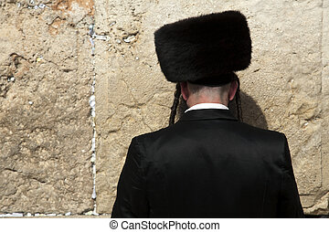 Seeking God - An orthodox Jewish senior man pressed in...