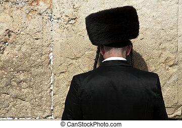 Seeking God - An orthodox Jewish senior man pressed in...