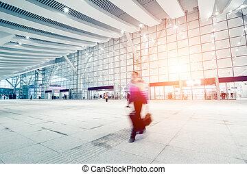passengers motion blur in shenzhen train station waiting...