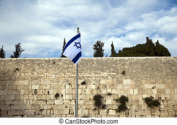Israel Flag and The Wailing Wall - Israel flag fluttering in...