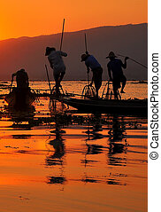 Fishermen in Inle lakes sunset. - Fishermen is finish a day...