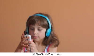 Girl with music player - close-up