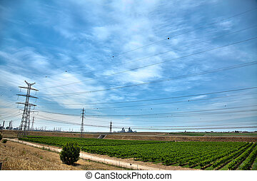 Power Lines, field and Phosphate Quarry - View at power...