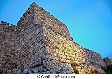 Old Jerusalem City Wall at Dusk - Part of the wall of the...