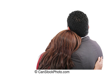 Rear view of a loving couple standing with arms around