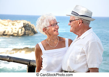 happy elderly couple looking in each other\\\'s eyes
