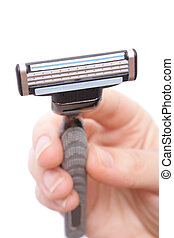 shaver in hand on white background (close up)