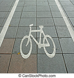 Bike lane symbol on road