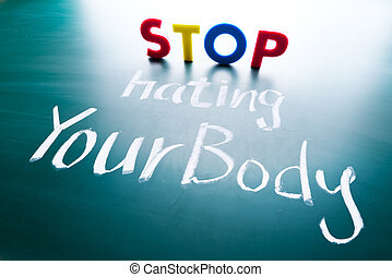 Stop hating your body concept, colorful words on blackboard