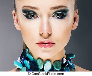 Glamorous Confident Woman in Semi Precious Turquoise...