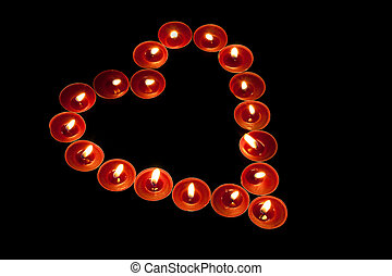 Red tealights in heart shape - red tealight candles arranged...