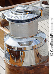Winch - Close-up of a big cromed winch on a wooden sailboat