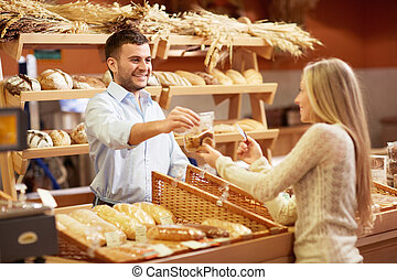 Bakery - Young girl in a store buying product