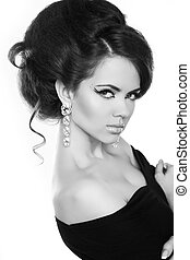 Portrait of young beautiful woman with fashion hairstyle, black and white photo