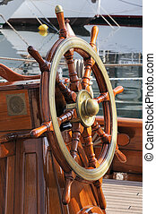 Rudder - Steering wheel on a wooden boat