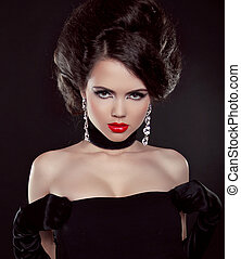 Portrait of beautiful brunette woman with red lips over dark