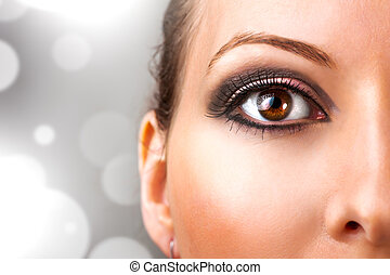 Woman with beautiful eye makeup - close up photo of...