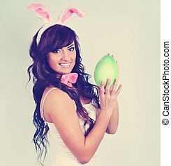 Beautiful rabbit holding an egg,tinted - Beautiful woman...
