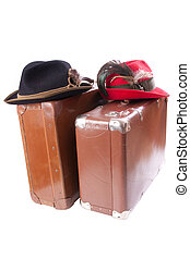 Two vintage suitcases with tradition Bavarian hats