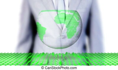 Businessman selecting environmental images on futuristic...