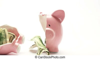 Piggy bank splitting in two with ca