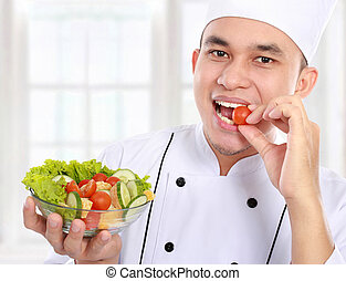chef with healthy food - Portrait of confident male chef...