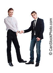 two fashionable young men greet each other
